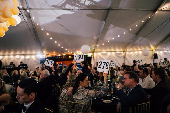Bidding at the Haring Center 2016 Auction